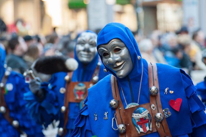 People in Grey Carnival Masks