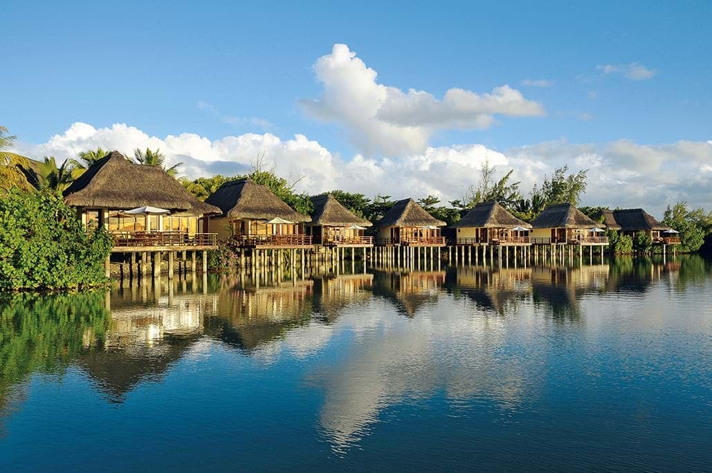 Overwater bungalows on seashore in Mauritius