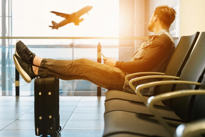 man waiting for flight