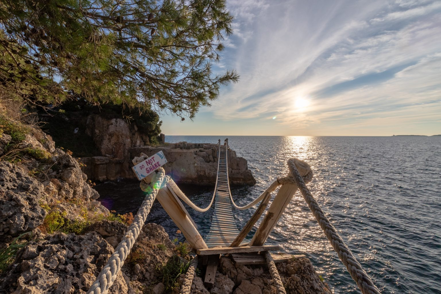 Small wooden bridge connecting two islands in Pula Croatia